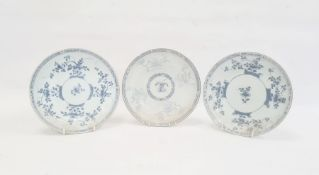 Pair of blue and white plates each decorated with trailing blossom with diaper borders, 22cm