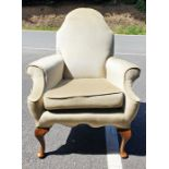Perhaps 1930's armchair, the shaped back in green velour upholstery, on cabriole legs