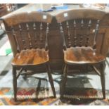 Pair of modern stained pine spindle back kitchen chairs (2)