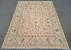 Large kilim, the central panel decorated with flowers with stylised flowers and plants within a wide