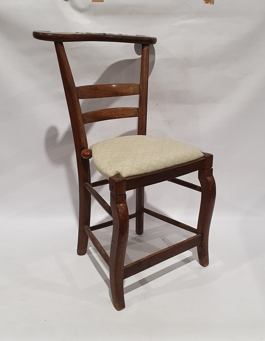 Unusual vintage chair, the shaped top rail over folding seat, cabriole legs