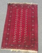 Modern Afghan rug, the central field with elephant foot guls and multiple borders, on a red