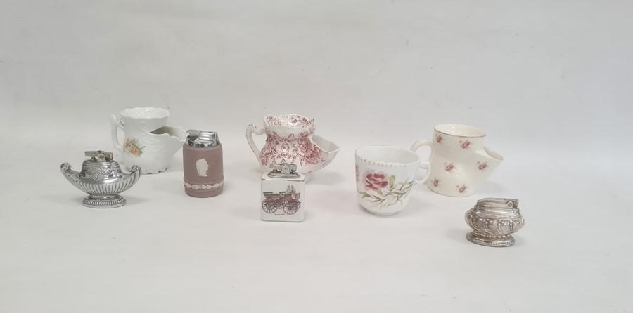 Three pottery shaving mugs, a porcelain moustache mug and four table lighters (8)