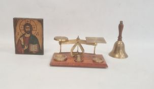 Pair of brass postal scales on rectangular wooden base, a brass bellwith turned wooden handle and a