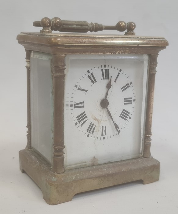 Brass and glass carriage clockwith Roman numerals to the dial
