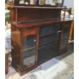 19th century rosewood breakfront chifonnierwith three-quarter gallery top on turned supports,