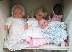 Four composition dolls and a quantity of dolls accessories