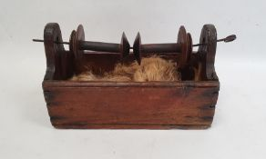 19th century winderfitted with two wooden spools over a pine base, 26cm long