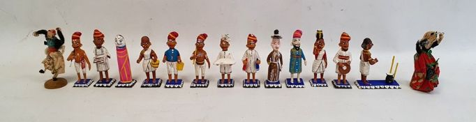 Quantity of painted wooden figureseach depicted in traditional dress, in painted wooden box