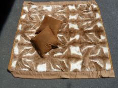 A (Llama) Guanaco throw, backed by gold coloured satin, labelled Hockley, 231 x 241 cms and two