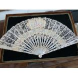 19th century mother-of-pearl painted lace flower fanwith cartouche and panel, floral and bird