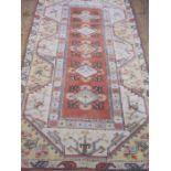 Oriental carpet manufacturer's wool rugin yellow, orange and blues, 216cm x 124cm