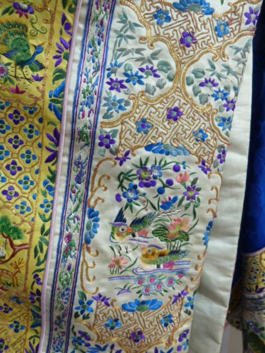 Chinese embroidered silk robe, brass button with relief pattern and silk loop fastenings, borders - Image 5 of 18
