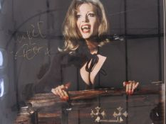 Ingrid Pitt signed and framed photograph, 29.5cm x 49cm