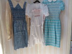 Three various child's dresses, circa 1950's with smocking and embroidered detail, a child's romper