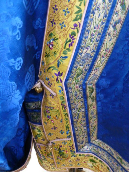 Chinese embroidered silk robe, brass button with relief pattern and silk loop fastenings, borders - Image 3 of 18