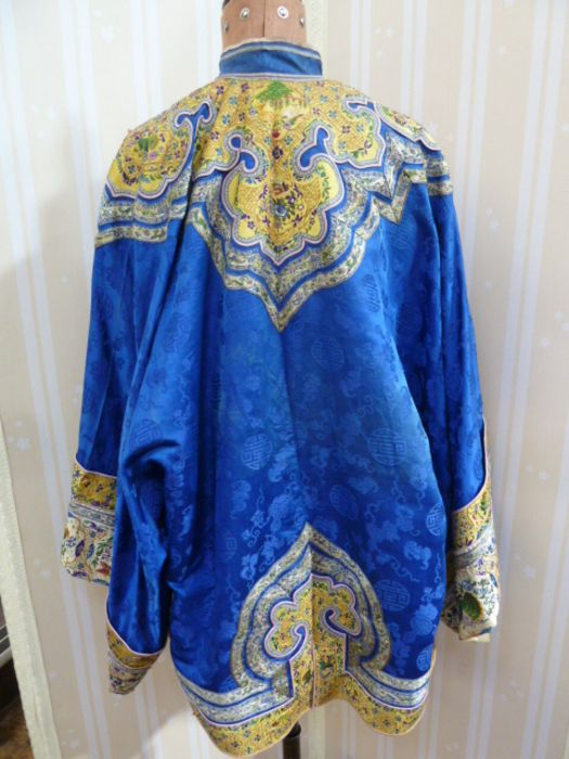 Chinese embroidered silk robe, brass button with relief pattern and silk loop fastenings, borders - Image 2 of 18