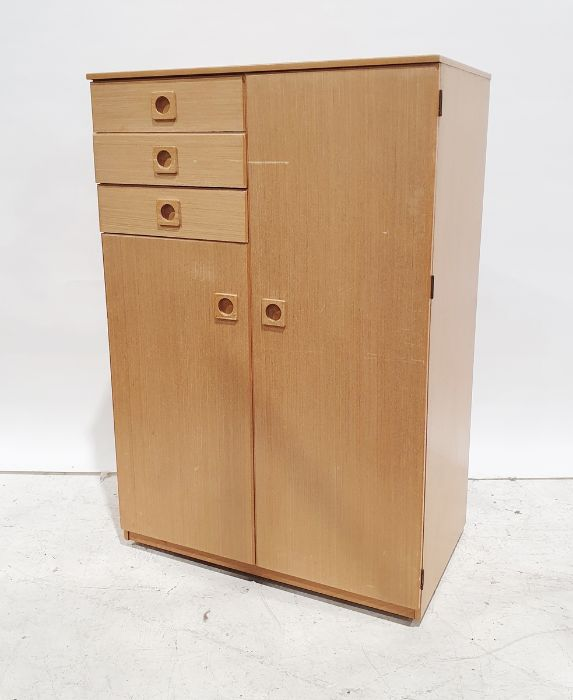 A 20th century light wood small compactum/wardrobe comprising of three small drawers and two