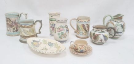 Two studio pottery mugsboth with painted leaf decoration, another with painted interior scene,