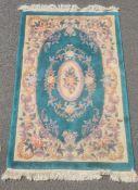 Chinese superwash green ground rug