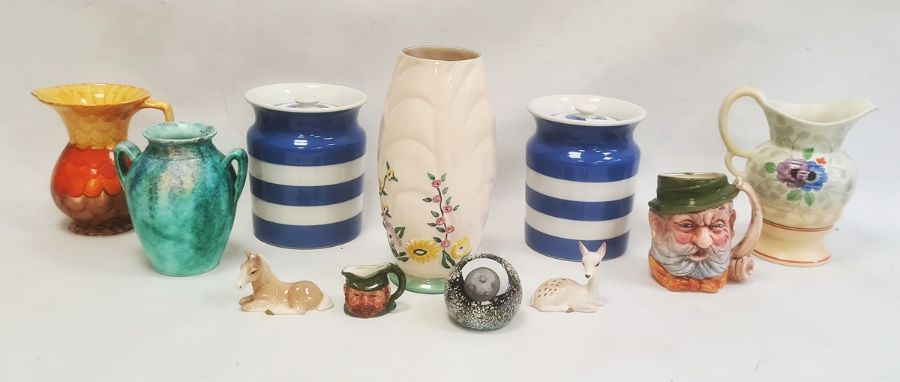 Pair of Green's Cornish ware lidded jars, a character jug, a Caithness paperweight 'Adventure' and
