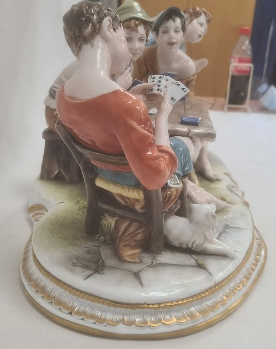 Ciche porcelain figural groupof boys seated at a table playing cards, the oval base with gilt - Image 4 of 6