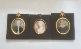 Pair of portrait miniatures on ivory, oval, head and shoulders portraits of a lady and gentleman,