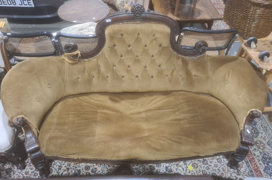Early Victorian sofawith mahogany carved show frame, turned and carved front legs to white china