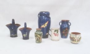 Royal Torquay pottery vasedecorated with water lilies and butterfly on a blue ground, 29cm high,
