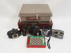 Pair of Dunhill Eagle 12x30 binocularsin leather case, a travelling chess set, a small vintage
