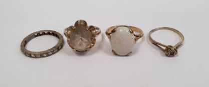 9ct gold white opal set ring, a 9ct gold and single solitairediamond set ring, 1mm in diameter
