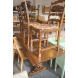 Oak extending table and four chairs (5)