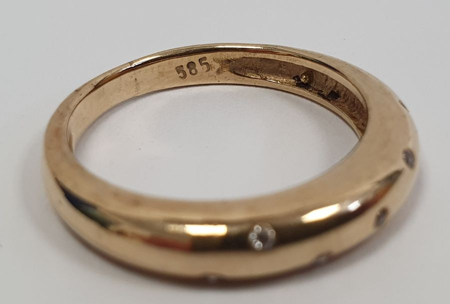 Gold ringset with seven small diamonds in rubover setting, marked 585, finger size P1/2, approx. - Image 3 of 5
