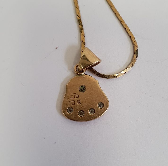 9ct -10ct gold pendant set with four small diamonds on a 9ct gold chain, 4g approxand a 10ct gold - Image 2 of 3