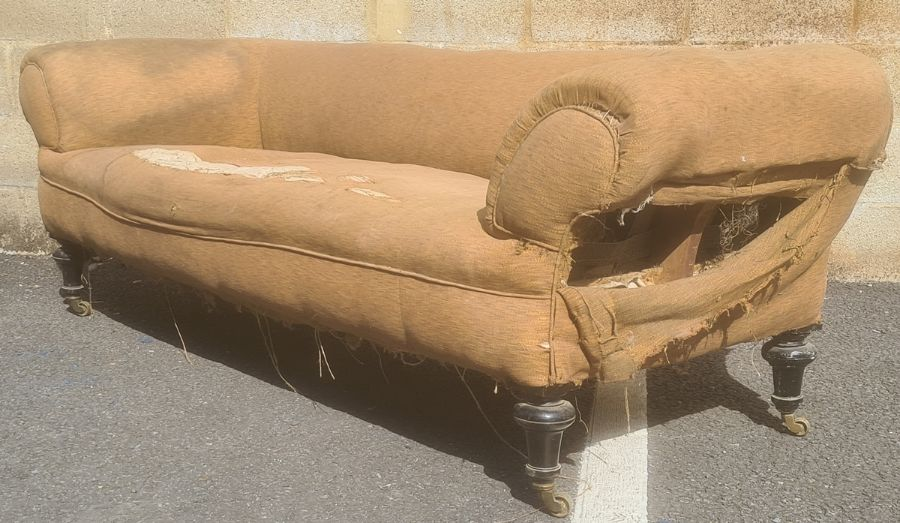 In the manner of Howard & Sons of London three-seat Chesterfield sofaon turned legs, brass Howard-