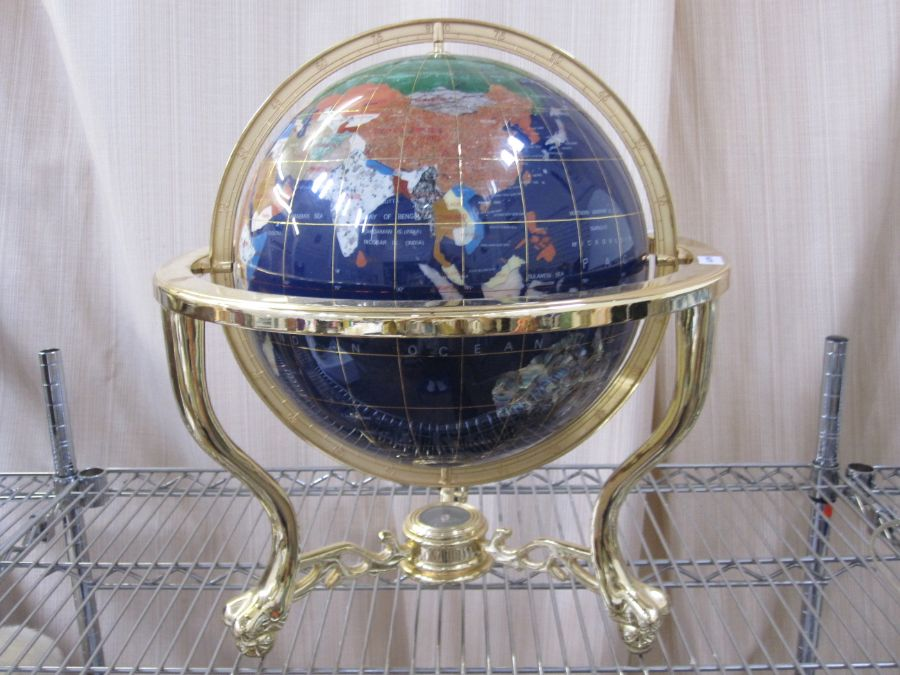 20th century globe in brass-coloured stand, with countries made from various hardstones, compass