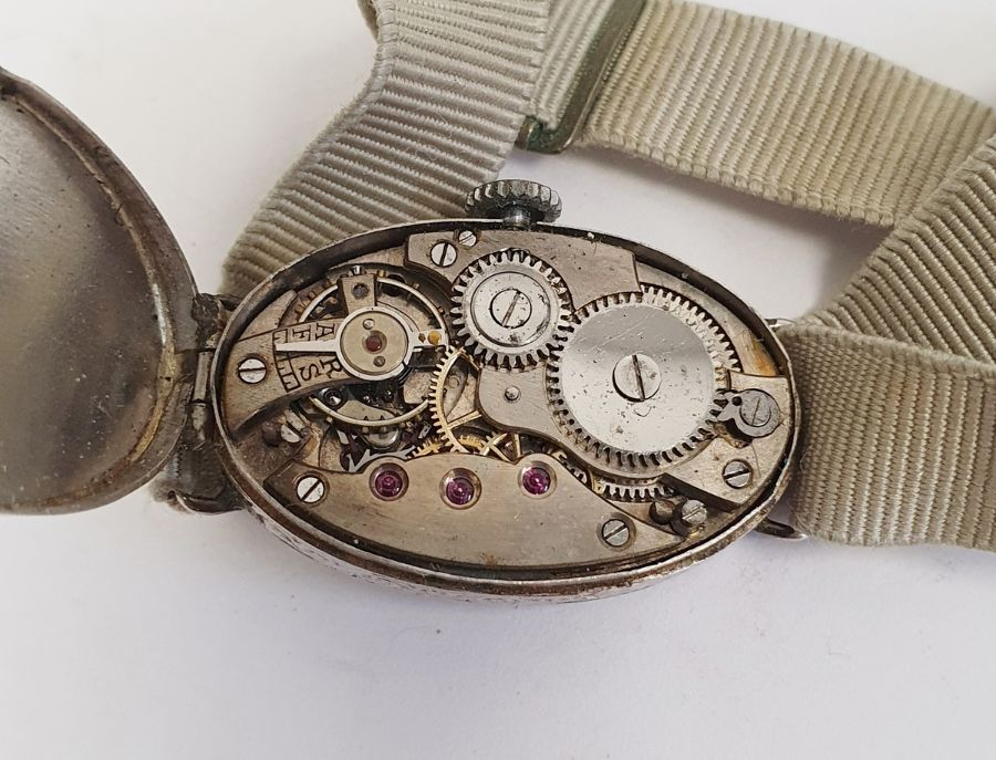 A 1920s platinum and diamond lady's wristwatch on fabric strap, oval with Arabic numerals and an - Image 5 of 10