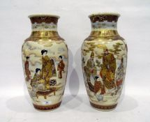 Pair of late 19th century Japanese Satsuma baluster vases, painted and richly gilt with figures