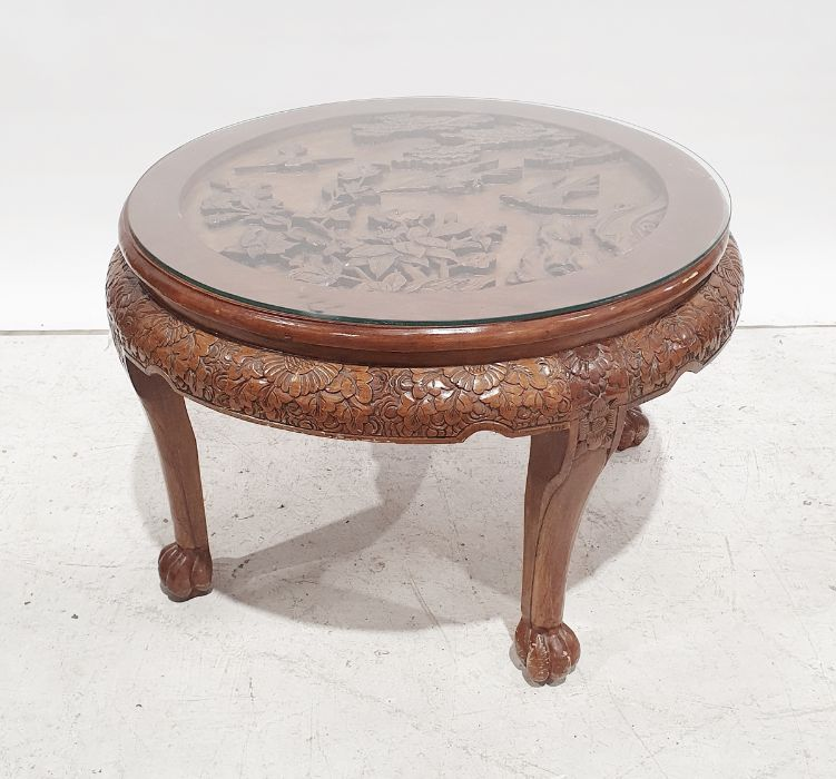 20th century Chinese hardwood circular table, carved decoration, 80cm diameter approx.