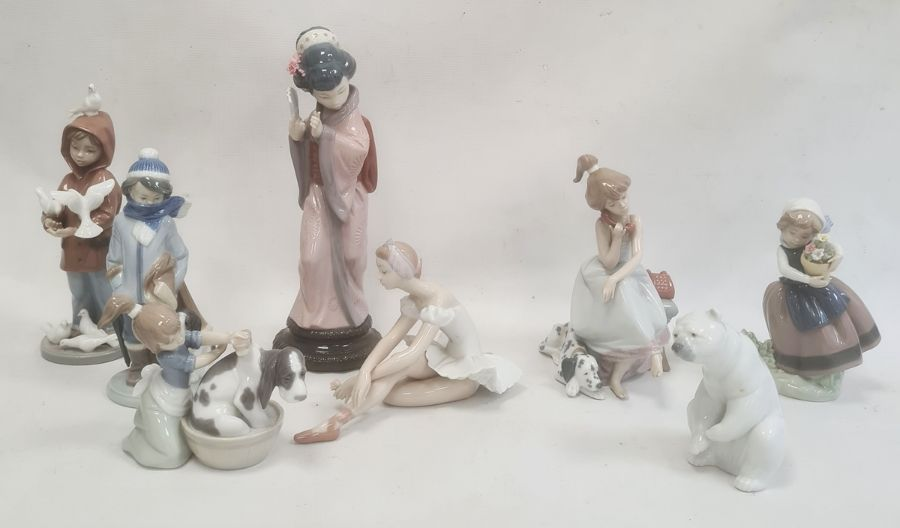Quantity of Lladro figuresto include Geisha girl, polar bear, girl grooming dog, boy with