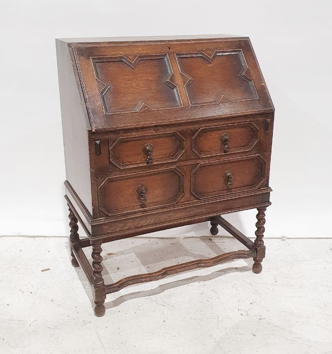 20th century oak bureau of two long drawers, shaped stretchers, barley twist and block supports,