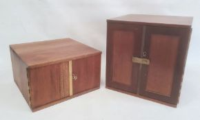 Two coin collector's cabinets each with a pair of doors enclosing assorted coin drawers (2)