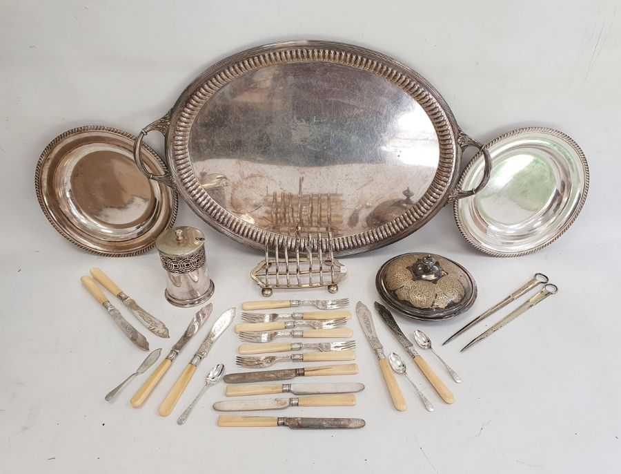 Quantity of plated ware to include a two-handled tray, flatware, toast rack, etc. (1 box)