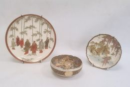 Japanese Satsuma platedepicting men in a bamboo forest, 21cm diameter, a Satsuma plate depicting