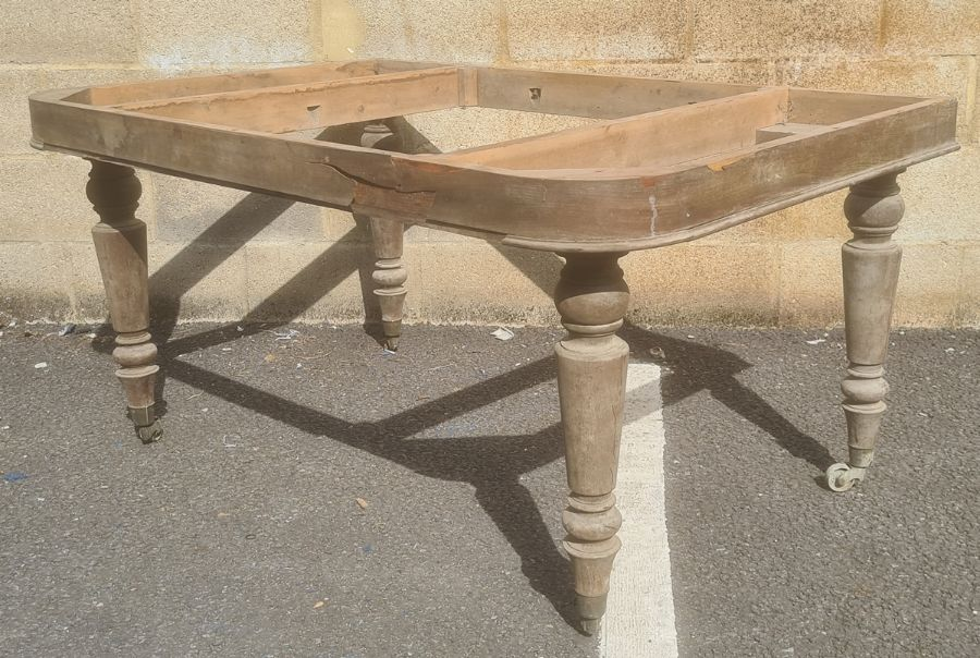 In the manner of Gillows of Lancaster table framewith four Gillows type turned legs, brass caps and