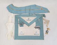 Old brown leather case of masonic regalia to include sash, enamelled badge, white metal pendant