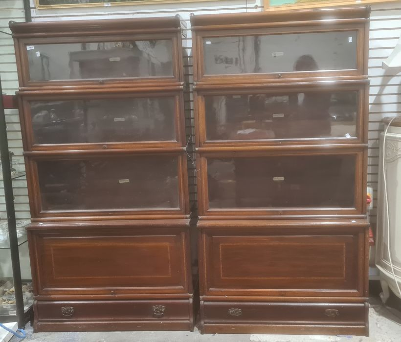 Pair of four-section Globe Wernicke mahogany and satinwood banded sectional bookcases with ivorine