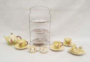 Carlton ware teapotof yellow leaf design, with hollyhock decoration, a matching cup and saucer,