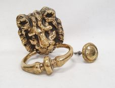 Brass door knockermodelled as a lion's mask with ring handle and knocking plate