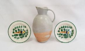 Pair of nineteenth century pottery platesdecorated with yellow and brown birds, within green